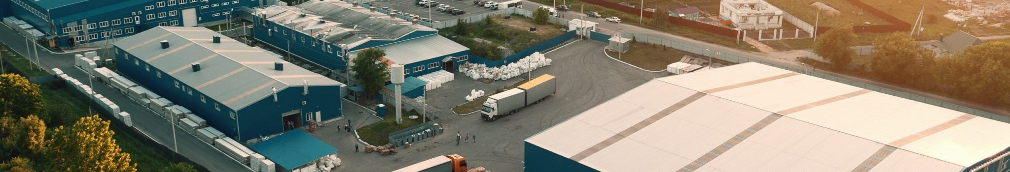 Aerial,View,Of,Warehouse,Storages,Or,Industrial,Factory,Or,Logistics